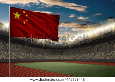 Chinese Flag in front of a Track and field Stadium with fans