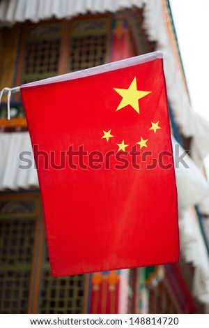 Chinese flag on a traditional Tibetan house in Lhasa, China, 2013 - stock photo