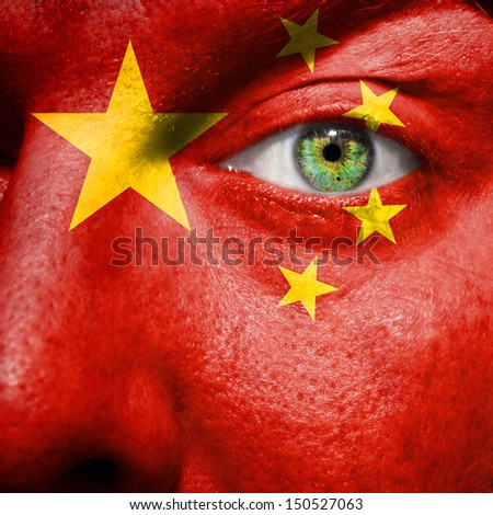 Chinese flag painted on a man's face to support his country China