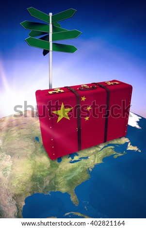 Chinese flag suitcase against purple sky - stock photo