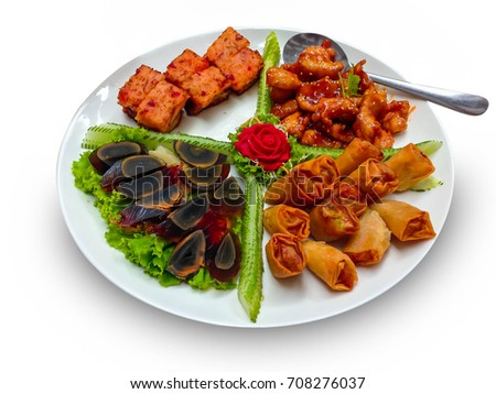 Chinese food, black preserved egg or century egg, fried Chinese Traditional spring rolls food, grilled fish, chicken with sweet and sour sauce on white plate and spoon,healthy food on white background