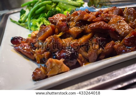 Chinese food buffet self service Teriyaki chicken with broccoli