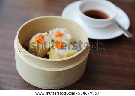 Chinese food dim sum in bamboo basket