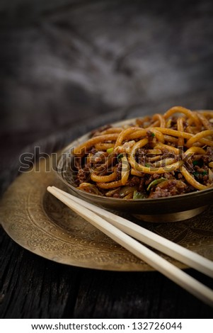 Chinese food. Egg noodles with chicken and vegetables - stock photo