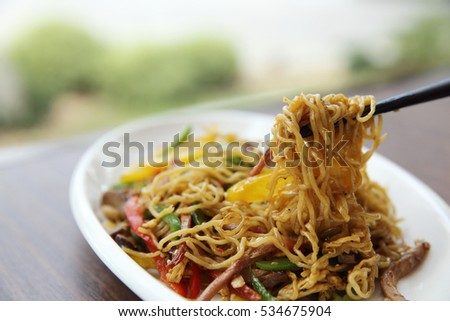 Chinese food fried noodle with ham