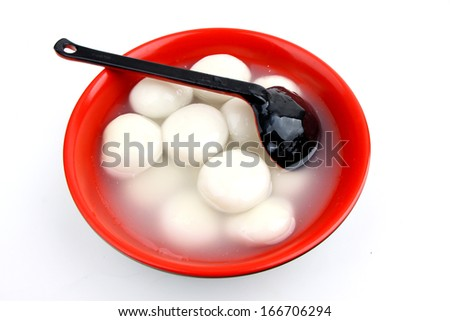 chinese food glue pudding in a bowl closeup photograph isolated on white background