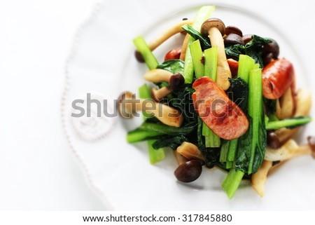 Chinese food, green leaf vegetable and Shimeji mushroom stir fried - stock photo