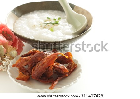 Chinese food, rice porridge and fried wheat gluten  - stock photo