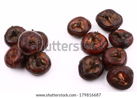 chinese food water nut in piles isolated on white background