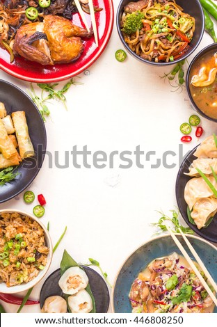 Chinese food white background. Chinese noodles, fried rice, dumplings, peking duck, dim sum, spring rolls. Famous Chinese cuisine dishes set. Space for text. Top view. Chinese restaurant concept - stock photo