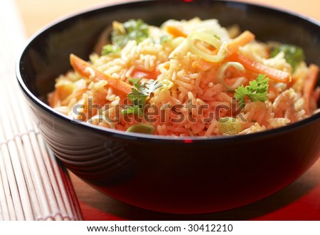 Chinese food with rice and sauce with vegetables and meat - stock photo