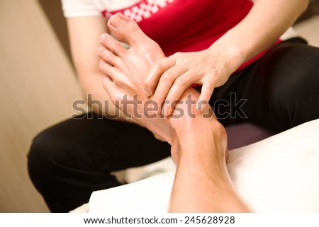 Chinese foot acupuncture and massage - stock photo