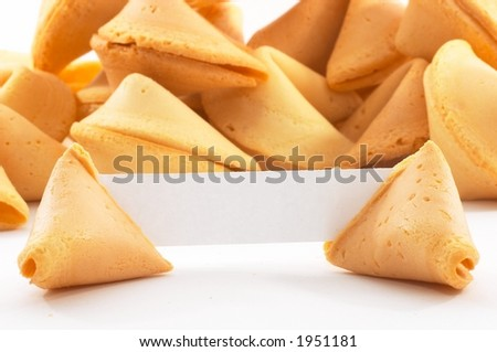 Chinese fortune cookies, on white background, with a white piece of paper for entering own text/fortune, closeup for bigger text input - stock photo