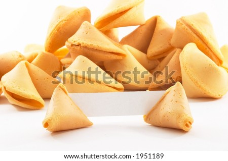 Chinese fortune cookies, on white background, with a white piece of paper for entering own text/fortune, bigger stack of cookies in background - stock photo