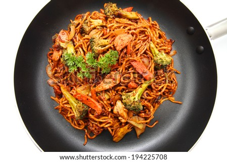 Chinese Fried Noodle in a frying pan isolated on white  - stock photo