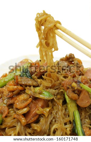 Chinese Fried Noodle with chopstick isolated on white