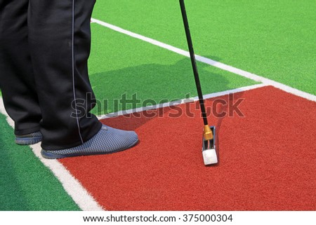 Chinese gate ball and athlete's legs, closeup of photo - stock photo