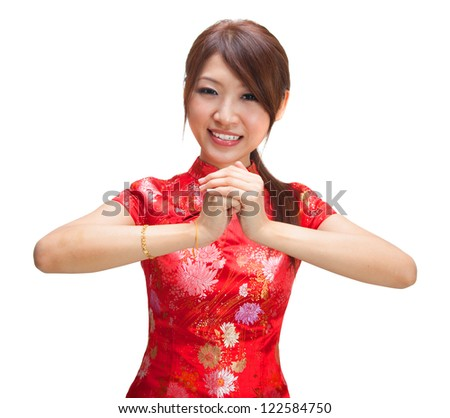 Chinese girl in traditional Chinese cheongsam greeting, isolated on white background