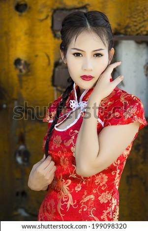 Chinese girl red dress traditional cheongsam - stock photo