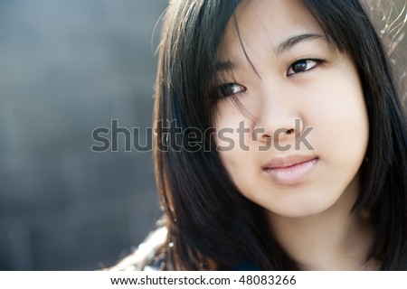 Chinese girl wearing modern clothes - stock photo