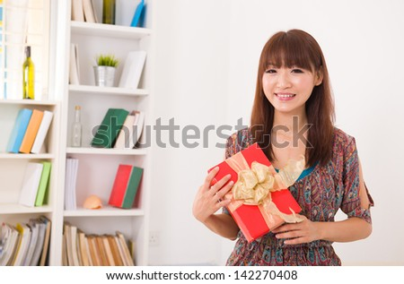 chinese girl with present and shopping - stock photo