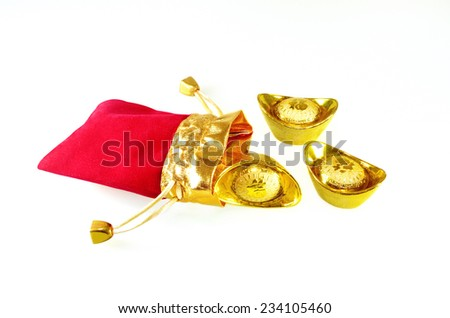 Chinese gold ingots with red packet - stock photo