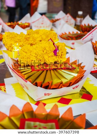 Chinese gold paper in Chinese traditional for burning to the death people or spirits - stock photo