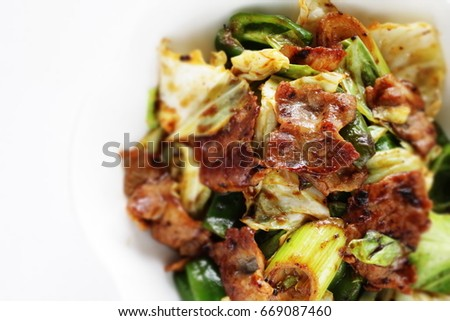 Chinese gourmet, pork and Napa cabbage stir fried with black bean sauce