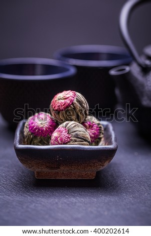 Chinese green tea balls with flowers, tea cup
