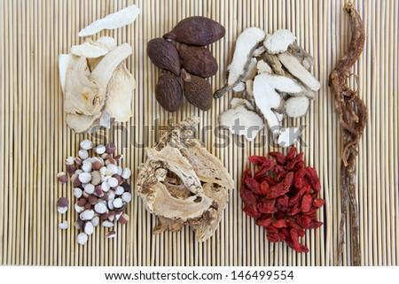 Chinese herb medicine ingredints on a bamboo mattress  - stock photo