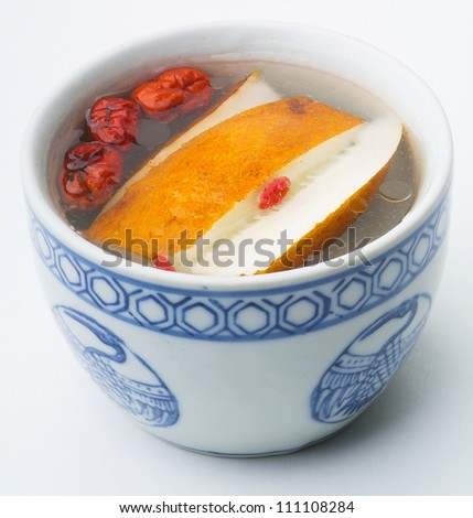 chinese herb soup in pot, Chinese food style - stock photo