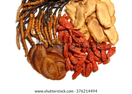Chinese Herbal medicine -  Ginseng slices, goji, antlers  and Cordyceps sinensis on white background, close-up - stock photo