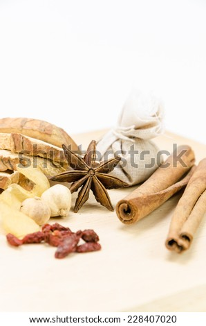 Chinese herbal medicine on wood - stock photo