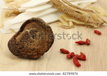 Chinese herbal medicine on wood background - stock photo