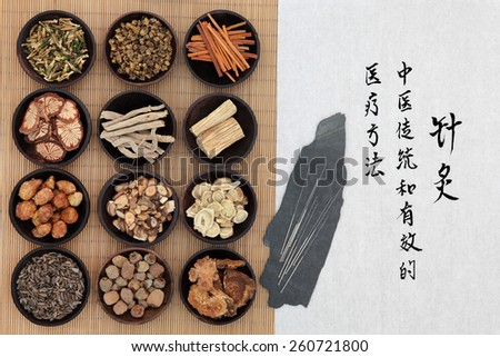 Chinese herbal medicine with acupuncture needles and calligraphy script. Translation describes acupuncture chinese medicine as a traditional and effective medical solution. - stock photo