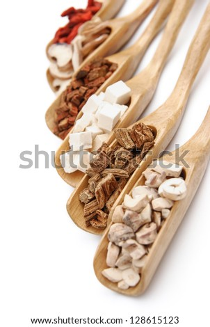 chinese herbs on wooden spoons