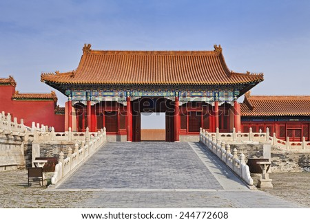 Chinese imperial forbidden city in Beijing - internal red gate with ramp and roof front view - stock photo