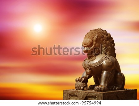 Chinese Imperial Lion Statue at sunset - stock photo