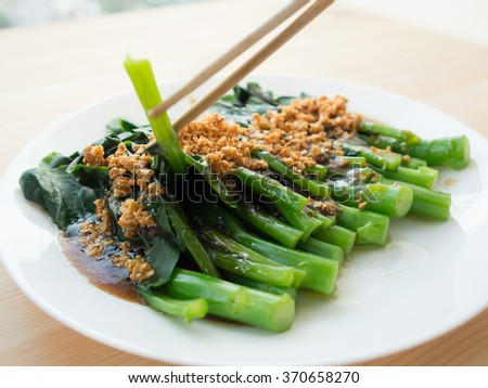Chinese kale on oyster sauce. - stock photo