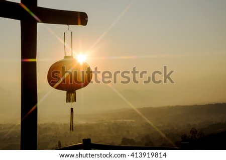 Chinese lanterns with colorful of sun rays made with star filter and mountain view - stock photo