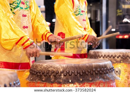 Chinese lion dance drummer beating drum in the show - stock photo