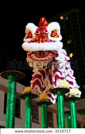 Chinese lion dance jumping on high poles
