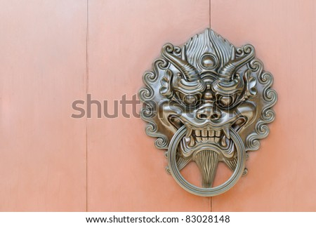 Chinese lion door knob at the right