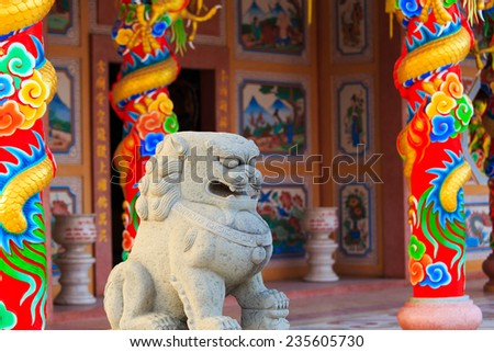 chinese lion statue in front of chinese temple in Thailand