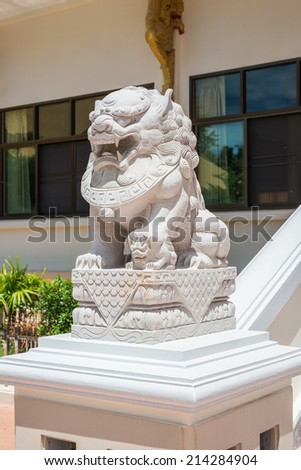 chinese lion statue in temple thailand - stock photo