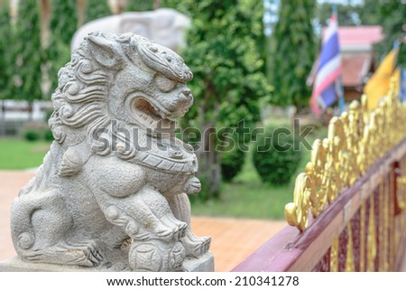 chinese lion statue in thailand - stock photo