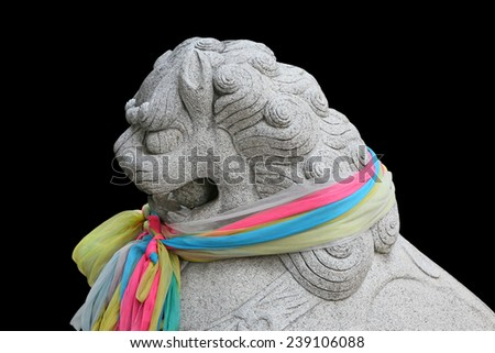 Chinese lion statue isolated on black background - stock photo