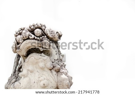 Chinese lion statue on white background in chinese temple - stock photo