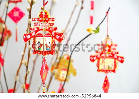 Chinese Lunar New Year decoration on tree signifying the spring season. For New Year objects, celebration and festival, and culture and lifestyle concepts. - stock photo