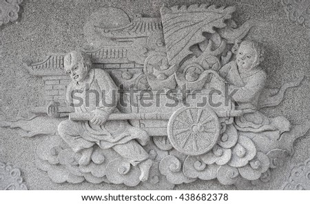 Chinese man and woman with cart of gold marble carving wall, Decorative Chinese art style in Chinese public temple - stock photo